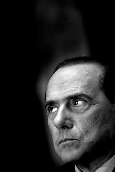 Italian Prime Minister Silvio Berlusconi looks up during a joint news conference with italian far right exponent and grandoughter of former italian fascist dictator Benito Mussolini,Alessandra Mussolini at Palazzo Marini in Rome february 17 2006.Berlusconi and rightwing politician Mussolini announced their electoral accord today in the forthcoming elections scheduled for the 9th and 10th of april.