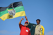 Two men with ANC flag commemorate the struggle against apartheid in South Africa and celebrating the worker rights during Mayday at the 1st of May.