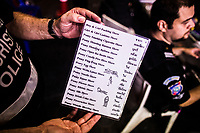 A Foreign Tourist Police volunteer holds up a laminated card describing numerous possibly disturbing sexual acts in Pattaya, Thailand. Many go-go bars along Walking Street in Pattaya will attract tourists into their establishments with promises of strange sexual shows such as these.