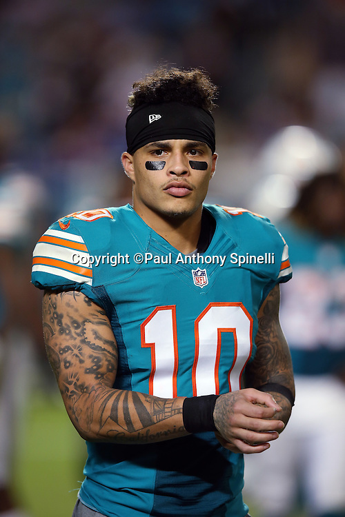 Miami Dolphins wide receiver Kenny Stills (10) looks on during the NFL week 14 regular season football game against the New York Giants on Monday, Dec. 14, 2015 in Miami Gardens, Fla. The Giants won the game 31-24. (©Paul Anthony Spinelli)