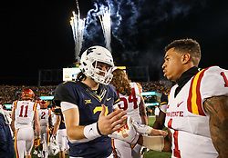 Nov 4, 2017; Morgantown, WV, USA; West Virginia Mountaineers quarterback Will Grier (7) talks with Iowa State Cyclones defensive back D'Andre Payne (1) after the game at Milan Puskar Stadium. Mandatory Credit: Ben Queen-USA TODAY Sports