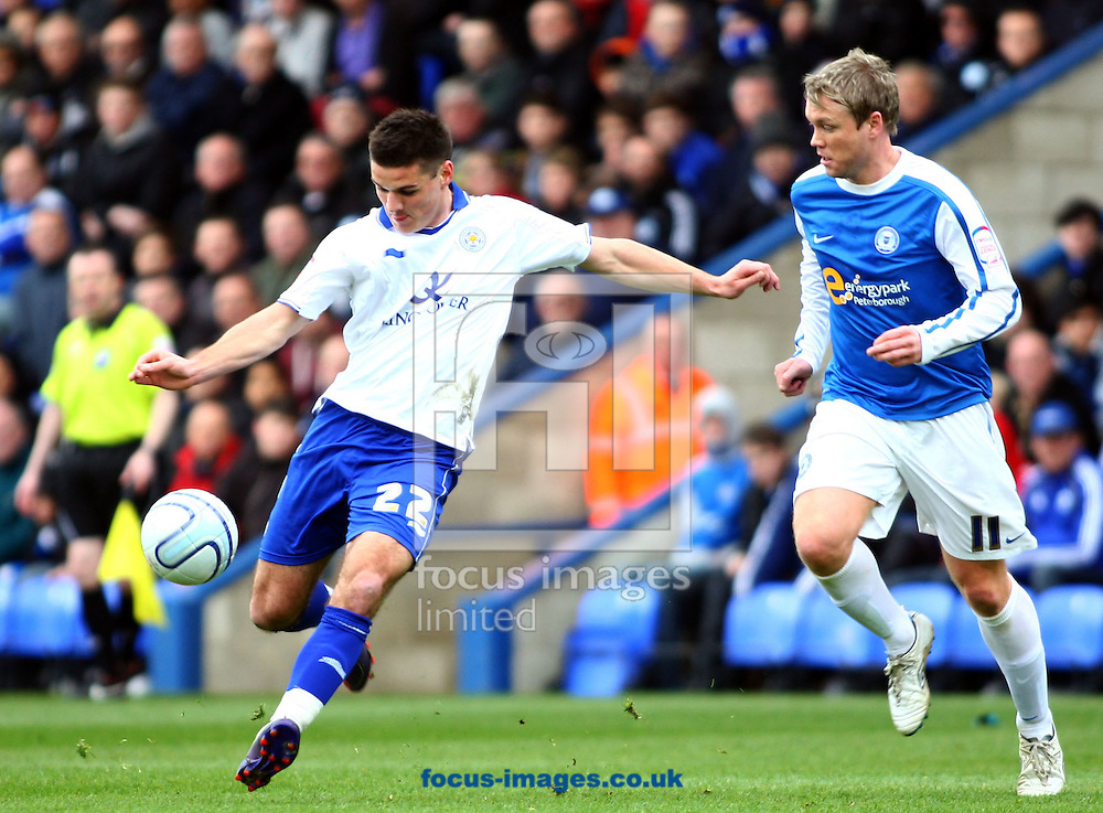 Picture by Rob Fisher/Focus Images Ltd. 07545 398891.31/03/12.Captain Grant McCann of Peterborough United looks on as Ben Marshall of Leicester City has a shot on goal during the Npower Championship match at London Road stadium, Peterborough.