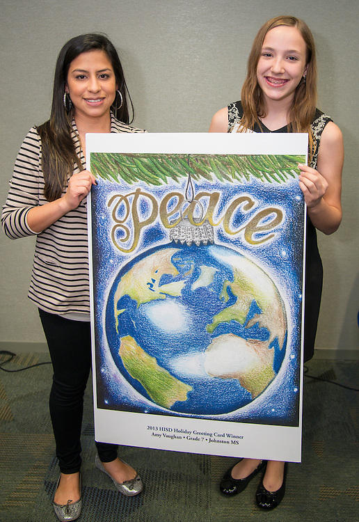 Johnston Middle School art teacher Christine Gutierrez poses with Amy Vaughn and her winning design during the Houston ISD official holiday card reception, November 8, 2013.