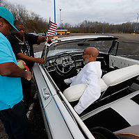 Thomas Wells   BUY AT PHOTOS.DJOURNAL.COM<br /> Larry Fisher, from left, and Robert Dilworth put as American flag W.B. McShan's car as before he can get his car in line for Monday's motorcade to St. Paul Christian Life Center for the last Dr. Martin Luther King service in Tupelo.
