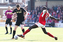 Ryan Colclough of Wigan Athletic takes on Toumani Diagouraga of Fleetwood Town - Mandatory by-line: Robbie Stephenson/JMP - 21/04/2018 - FOOTBALL - Highbury Stadium - Fleetwood, England - Fleetwood Town v Wigan Athletic - Sky Bet League One