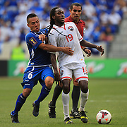 Keon Daniel, Trinidad and Tobago, (right) is challenged by  Richard Menjivar, El Salvador, during the El Salvador Vs Trinidad and Tobago CONCACAF Gold Cup group B football match at Red Bull Arena, Harrison, New Jersey. USA. 8th July 2013. Photo Tim Clayton