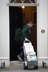 © London News Pictures. 12/12/2012. London, UK.   Pilsner Urquell lager and wine - Trolley number two of five containing alcoholic drinks and glasses being delivered to 11 Downing Street by Majestic wines on December 12, 2012. Photo credit: Ben Cawthra/LNP