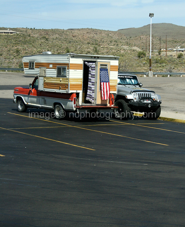 American flag attached to recreational vehicle in carpark in Arizona USA