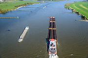 Nederland, Gelderland, Gemeente Tiel, 24-10-2013; duwboot Veerhaven X – Orka duwt zes duwbakken met erts en kolen op de Waal ter hoogte van Tiel.<br /> Pusher (tug) Veerhaven X - Orca pushing six barges with ore and coal on the Waal near Tiel.<br /> luchtfoto (toeslag op standaard tarieven);<br /> aerial photo (additional fee required);<br /> copyright foto/photo Siebe Swart.