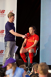 LIVERPOOL, ENGLAND - Monday, May 9, 2016: Liverpool's Natasha Harding is interviewed by Steve Hothersall at the launch of the New Balance 2016/17 Liverpool FC kit at a live event in front of supporters at the Royal Liver Building on Liverpool's historic World Heritage waterfront. (Pic by David Rawcliffe/Propaganda)