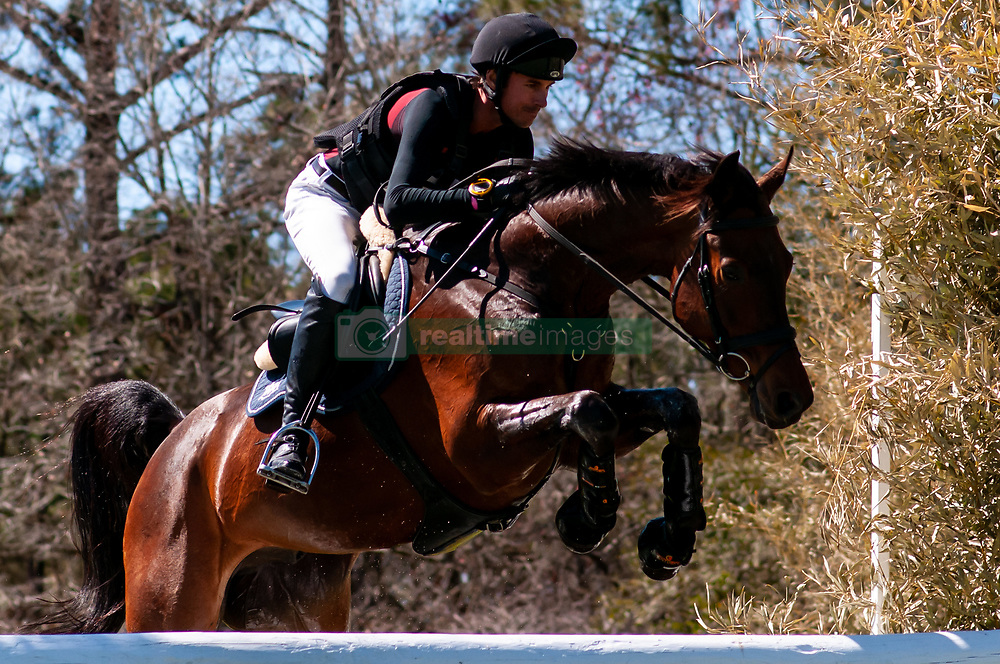March 22, 2019 - Raeford, North Carolina, US - March 23, 2019 - Raeford, N.C., USA - FELIX VOGG of Switzerland riding COLERO competes in the cross country CCI-4S division at the sixth annual Cloud 11-Gavilan North LLC Carolina International CCI and Horse Trial, at Carolina Horse Park. The Carolina International CCI and Horse Trial is one of North AmericaÃ•s premier eventing competitions for national and international eventing combinations, hosting International competition at the CCI2*-S through CCI4*-S levels and National levels of Training through Advanced. (Credit Image: © Timothy L. Hale/ZUMA Wire)