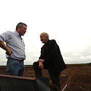 Irish farmer Enda Doran chats with a friend and neighbor in a bog land in Ballinasloe, Co. Galway...Mr. Doran is the eldest of 3 brothers and sisters and by tradition the heritor of the family farming land and business. His farming activities involve cereal and potato production, cattle and sheep breathing and contract work for other farmers.