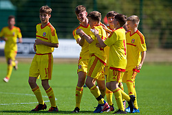 NEWPORT, WALES - Wednesday, July 25, 2018: Josh Carey celebrates scoring the first goal with Ryan Holmes and Iestyn Phillips during the Welsh Football Trust Cymru Cup 2018 at Dragon Park. (Pic by Paul Greenwood/Propaganda)