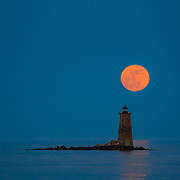 """A """"super moon"""" rises over Whaleback Lighthouse off Portsmouth, NH. May 5, 2012"""