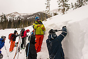 Diamond Peaks Ski Patrol member Lucas Moutett instructs Level 1 Avalanche Class students on how to dig and evaluate a hasty snow pit in Colorado State Forest State Park near Cameron Pass, January 12, 2013.