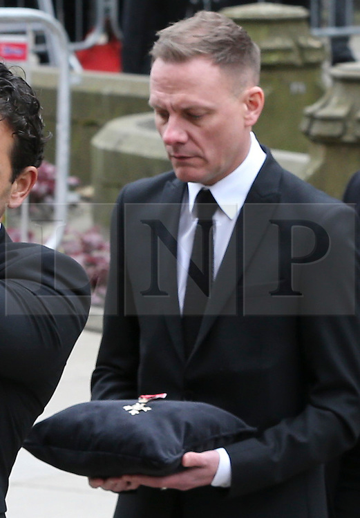 © Licensed to London News Pictures . 18/03/2016 . Manchester , UK . Antony Cotton carrying Tony Warren's mbe in to the service. Television stars and members of the public attend the funeral of Coronation Street creator Tony Warren at Manchester Cathedral . Photo credit : Joel Goodman/LNP
