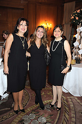 Left to right, TALA AHMED, MARINA TOMA and BURRAN GALIP  at a fashion show and lunch in aid of  AMAR International Charitable Foundation held at The Dorchester, Park Lane, London W1 on 9th October 2008.