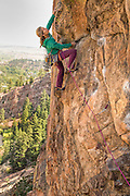 "Legendary climber Lynn Hill climbing""Outer Space"" 10b, Northwest Buttress of the Bastille, Eldorado Canyon, Colorado."