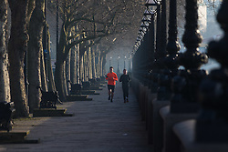London, February 24th 2016. Two runners jog along Cheyne Walk beside the River Thames as the sun rises on a chilly but clear morning in London. &copy;Paul Davey<br /> FOR LICENCING CONTACT: Paul Davey +44 (0) 7966 016 296 paul@pauldaveycreative.co.uk