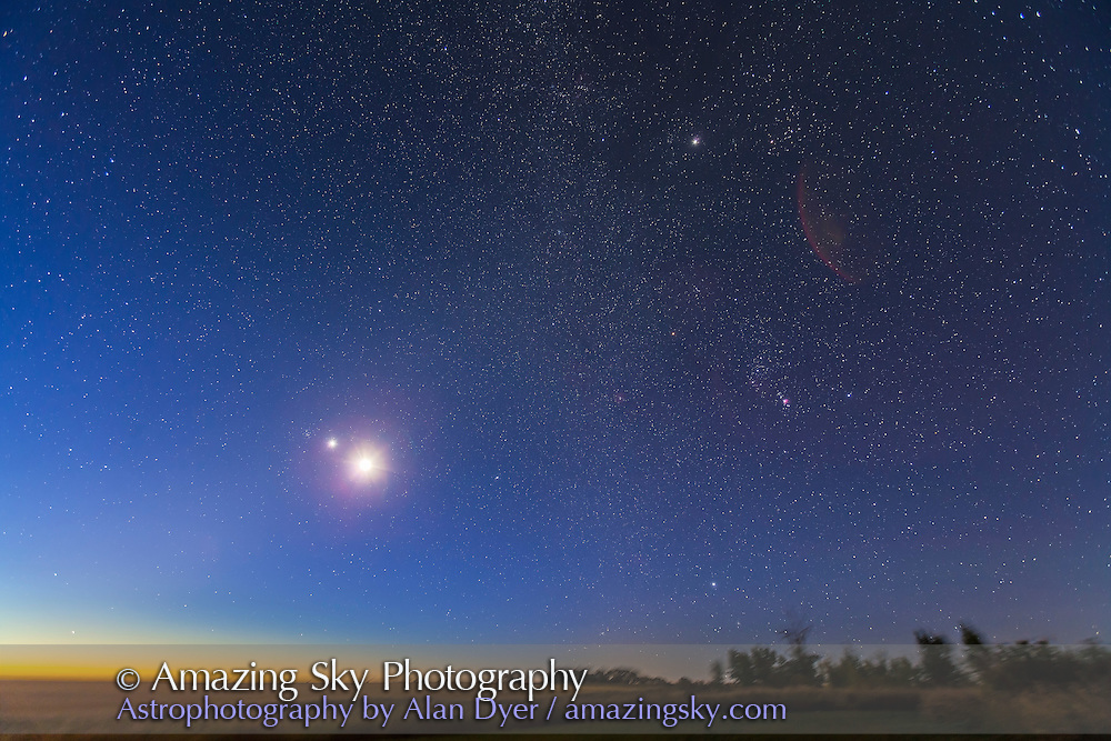 Venus and the waning crescent Moon at dawn, with Jupiter above in Taurus and Orion and Sirius at right. Venus and the Moon are just below M44, Beehive cluster in Cancer. Taken from home Sept 12, 2012, with Canon 5D MkII and 16-35mm lens at 16mm and f/4. This is a stack of two 2-minute exposures at ISO 800, with the ground from one exposure only.
