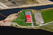 Nederland, Groningen, Oldambt, 01-05-2013; Blauwestad, nieuw aangelegd woongebied inclusief recreatiegebied. Het Oldambtmeer dient ook als waterberging. In de voorgrond het informatie en verkoopcentrum, daar achter nog onbebouwd de wijk 'het Dorp' en op het tweede plan 'De Wei' met kavels voor zelfbouw. Het project Blauwe Stad was oorspronkelijk bedoeld om de economisch achtergebleven regio van Noordoost Groningen een impuls te geven. De economische en huizen crisis gooit echter roet in het eten.<br /> <br /> Blauwestad (Blue City) newly constructed residential area, including recreational lake. The Oldambt lake also serves as water storage. In the foreground information and sales center, behind it the still undeveloped area 'the Village', on the second plan 'De Wei' (Meadow) with plots suited for 'DIY' buidling of houses. The Blue City project is meant to give a boost to the  economically backward region of northeast Groningen.<br /> luchtfoto (toeslag); aerial photo (additional fee required);<br /> foto Siebe Swart / photo Siebe Swart