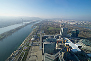 Vienna, Austria. After its opening in February 2014, DC Tower designed by French star architect Dominique Perrault in cooperation with Hoffmann-Janz Architekten is Vienna's highest skyscraper with 250 meters. View over Millennium-Tower (l.), Donau (Danube river), Donauinsel (Danube Island), Donaucity and Austria Center from the top floor.