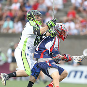Mike Stone #41 of the Boston Cannons keeps the ball away from Mike Unterstein #65 of the New York Lizards during the game at Harvard Stadium on July 19, 2014 in Boston, Massachusetts. (Photo by Elan Kawesch)