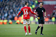 Referee Darren England shows a yellow card to Middlesbrough midfielder Jonathan Howson (16)  during the EFL Sky Bet Championship match between Middlesbrough and Leeds United at the Riverside Stadium, Middlesbrough, England on 9 February 2019.
