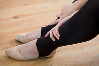 Young woman resting from ballet rehearsal