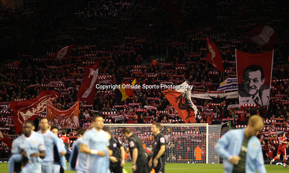 25/01/2012 - Carling Cup Semi-Final (2nd Leg) - Liverpool vs. Manchester City - Liverpool fans wave their flags and banners in The Kop stand as Man City players prepare to kick-off - Photo: Simon Stacpoole / Offside.