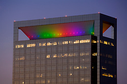 Colorful rainbow lights on Memorial Hermann Medical Plaza at night.