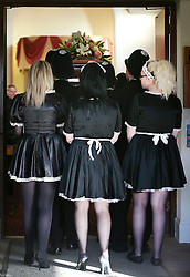 © Licensed to London News Pictures. 09/12/2015. London, UK. Three women dressed in maids uniforms follow the coffin in to the service. The funeral of former brothel keeper Cynthia Payne takes place at the South London Crematorium.  In 1980 Cynthia Payne was sentenced to 18 months for running a brothel at her house on Ambleside Avenue in Streatham. It was alleged, at the time, that judges and Members of Parliament were visitors to her establishment. Photo credit: Peter Macdiarmid/LNP