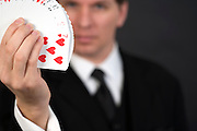 a magician showing a stack of cards