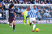 Juninho Bacuna of Huddersfield Town (7) escapes Matteo Guendouzi of Arsenal (29) during the Premier League match between Huddersfield Town and Arsenal at the John Smiths Stadium, Huddersfield, England on 9 February 2019.