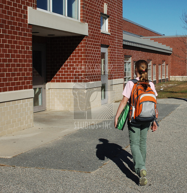 girl walking to school on a sunny day