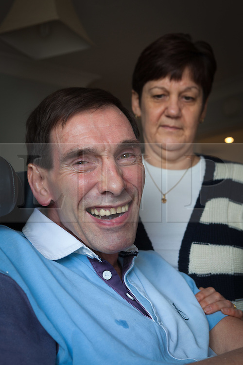 """© Licensed to London News Pictures File pic dated 15/10/2011. Melksham, UK. Portrait of Tony Nicklinson & wife Jane at their home in Melksham near Bath in October 2011. Mr Nicklinson suffered from """"Locked in Syndrome"""" after having a stroke in 2005. Tony fought for his right to end his own life and after finally losing his case in the High Court to allow doctors to end his life refused all food starved himself to death in August 2012. Photo Credit : Stephen Shepherd/LNP"""