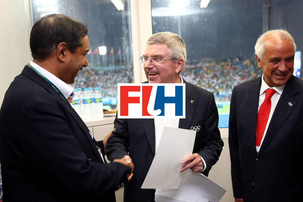 RIO DE JANEIRO, BRAZIL - AUGUST 18:  IOC President Thomas Bach (C) poses during an International Hockey Federation presentation during half-time of the Men's Hockey Gold Medal match between Belgium and Argentina on Day 13 of the Rio 2016 Olympic Games at Olympic Hockey Centre on August 18, 2016 in Rio de Janeiro, Brazil.  (Photo by Clive Brunskill/Getty Images)