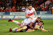 Two Hull KR players tackle a Giants player during the Betfred Super League match between Hull Kingston Rovers and Huddersfield Giants at the Hull College Craven Park  Stadium, Hull, United Kingdom on 21 February 2020.