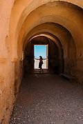 A woman stands in the doorway of a castle near Amman, Jordan