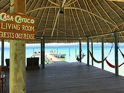 EXCLUSIVE: How about owning your own tropical Caribbean luxury resort for just $10. American couple Suzanne and Dave Smith are selling off their incredible Casa Cayuco Eco Adventure Lodge, in Bocas del Toro, Panama, Central America. But instead of listing their stunning multi-million-pound island getaway for sale they are offering the chance for anyone who buys a $10 ticket to win their extraordinary lifestyle and profitable business. Dave and Suzanne have spent five years turning a former rustic lodge into one that has just been voted number one resort on TripAdvisor in Panama. Their incredible two-acre slice of heaven is bordered by sloth-filled rainforest to the rear and crystal clear coral sea to the front. The lucky winner of the 24-guest resort will become owner of four stand-alone cabins, a main lodge, two lodge suites, and an air-conditioned luxury owner's suite designed by Dave and Suzanne themselves and built by skilled local carpenters. Outside, Casa Cayuco comes with its own jetty and thatch covered sun terrace as well as everything you need to run a business, including commercial kitchen communication tower, laundry and maintenance building and THREE power boats, each over 23-foot long. Kayaks, snorkelling, spear fishing and paddle boards and surf gear are also ready and waiting to be used by a new owner and guests alike. And if that's not enough, British competition organisers WinThis.Life https://winthis.life/index.aspx# are offering a $50,000 cash injection to welcome the new owners. All those wishing to take part have to do is buy one or more tickets and play a spot-the-ball-type competition on the website. Entries are being taken extension until April 11. Dave, 35, and Suzanne, 33, first arrived on the island in 2013 with just seven suitcases having decided to sell up from their home and corporate lives near Detroit, Michigan, USA. 16 Feb 2018 Pictured: Pic shows the living room for guests at the Caribbean resort Casa Cayuco in Panama which one
