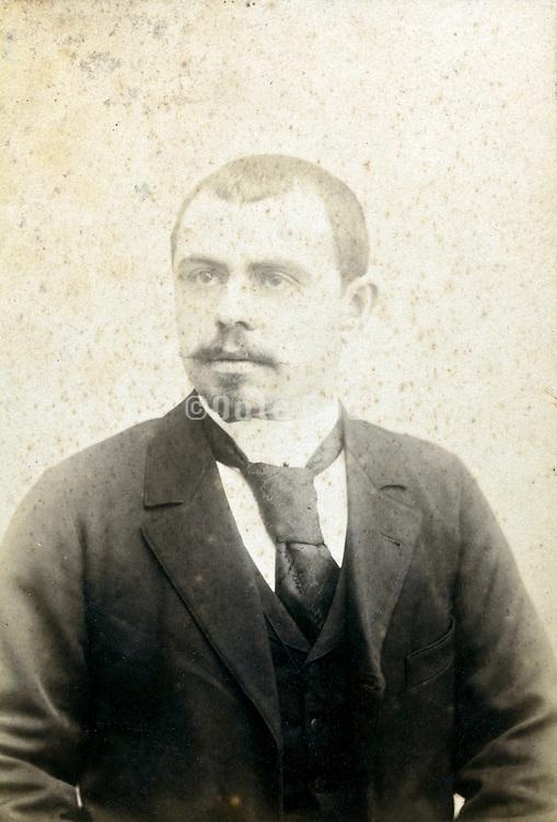 deteriorating studio portrait man late 1800s