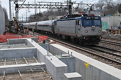 Amtrak Northeast Regional moves through The Railroad Station at Fairfield Metro Center while under Construction