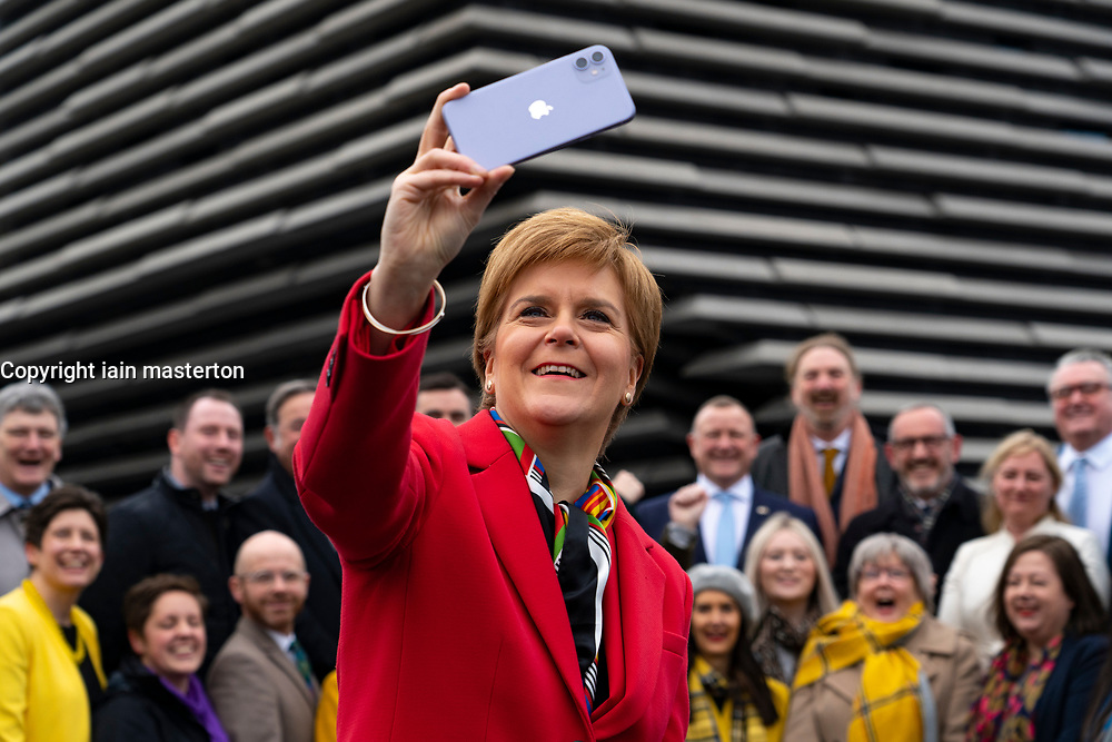 Dundee, Scotland, UK. 14th Dec 2019. First Minister Nicola Sturgeon at photo call with her SNP MPs outside the V&A Museum in Dundee. Many of the assembled MPs are newly elected to parliament. Iain Masterton/Alamy Live News