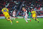 Ali Crawford of Doncaster Rovers (11) lines up a shot to score and make it 1-1 during the EFL Sky Bet League 1 match between Doncaster Rovers and AFC Wimbledon at the Keepmoat Stadium, Doncaster, England on 17 November 2018.