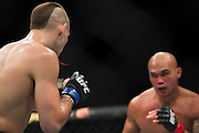 Blood flies out of Rory MacDonalds mouth against Robbie Lawler during UFC 189 at the MGM Grand Garden Arena in Las Vegas, Nevada on July 11, 2015. (Cooper Neill)