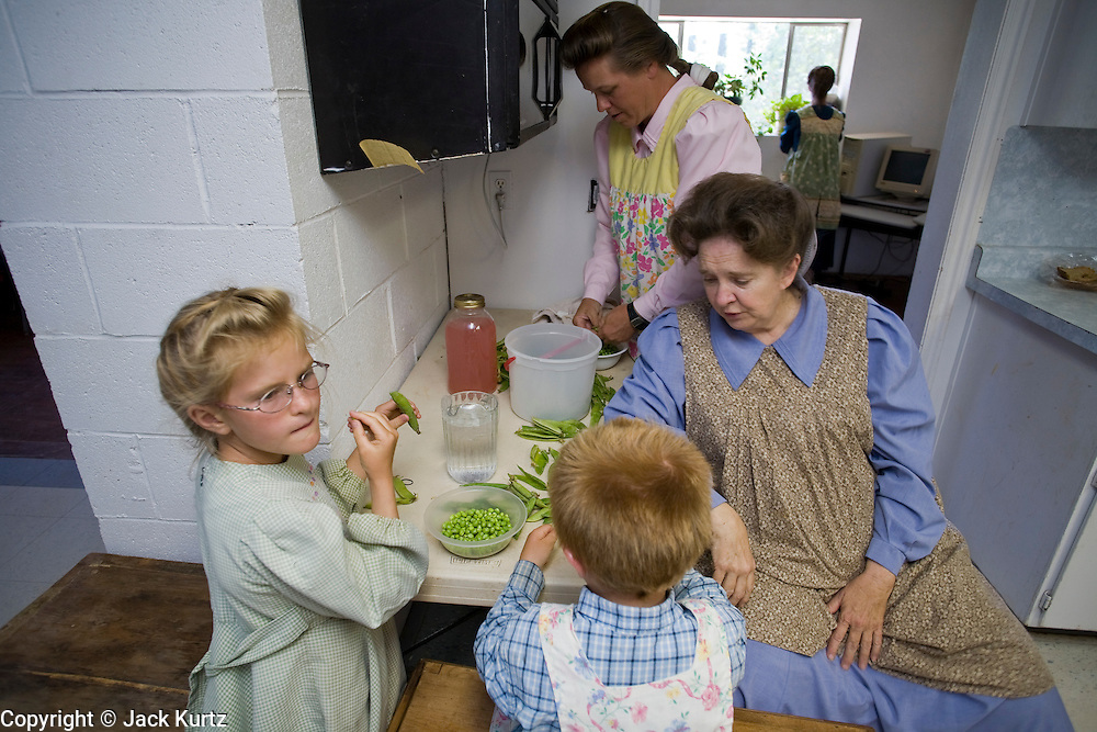 """Aug 10, 2008 -- COLORADO CITY: Women in the Jessop family prepare the family dinner in their home in Colorado City, AZ. The Jessops are polygamists and members of the FLDS. Colorado City and neighboring town of Hildale, UT, are home to the Fundamentalist Church of Jesus Christ of Latter Day Saints (FLDS) which split from the mainstream Church of Jesus Christ of Latter Day Saints (Mormons) after the Mormons banned plural marriage (polygamy) in 1890 so that Utah could gain statehood into the United States. The FLDS Prophet (leader), Warren Jeffs, has been convicted in Utah of """"rape as an accomplice"""" for arranging the marriage of teenage girl to her cousin and is currently on trial for similar, those less serious, charges in Arizona. After Texas child protection authorities raided the Yearning for Zion Ranch, (the FLDS compound in Eldorado, TX) many members of the FLDS community in Colorado City/Hildale fear either Arizona or Utah authorities could raid their homes in the same way. Older members of the community still remember the Short Creek Raid of 1953 when Arizona authorities using National Guard troops, raided the community, arresting the men and placing women and children in """"protective"""" custody. After two years in foster care, the women and children returned to their homes. After the raid, the FLDS Church eliminated any connection to the """"Short Creek raid"""" by renaming their town Colorado City in Arizona and Hildale in Utah.Photo by Jack Kurtz / ZUMA Press"""