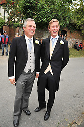 VISCOUNT ASTOR and his son the HON.JAKE ASTOR at the wedding of Lohralee Stutz and the Hon.William Astor at St.Augustine's Church, East Hendred, Oxfordshire on 5th September 2009.