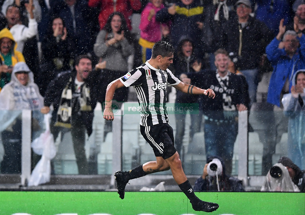 TURIN, Sept. 10, 2017  Juventus' Paulo Dybala celebrates after scoring during the Italian Serie A soccer match between Juventus and Chievo, in Turin, Italy, Sept. 9, 2017. Juventus won 3-0. (Credit Image: © Alberto Lingria/Xinhua via ZUMA Wire)
