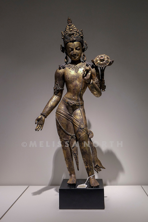 An Important Gilt-Bronze Figure of Avalokiteshvara<br /> from the touring highlights of The Collection of Robert Hatfield Ellsworth, <br /> at Christies in King St, London, UK on Tuesday 16th December 2014. In celebration of this unparalleled collection of Asian Art, Christie&rsquo;s will host a series of auctions and online-only sales during New York Asian Art Week in March 2015. Photo by Melissa North. Ref B5690