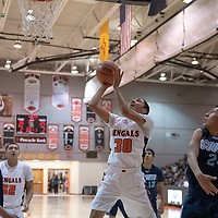 Joaquin Ortega (30) of Gallup gets the shot off under the basket as Marian Ynzuna (24) of Window Rock is charged with the foul during the Gallup Invitational Tournament game in Gallup. Gallup won 64-42.